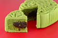Green mooncake closeup moon cake ob red box Stock Photos