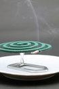 Green mosquito coil classic spiral on gray background Stock Photo