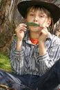 Green  Music - playing gumleaf Stock Image