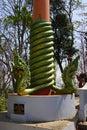 Green naga serpent on column sambuk mountain monastery kratie cambodia Stock Images