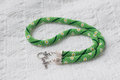 Green necklace from beads with flower drawing close up Stock Photo