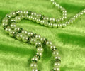 Green necklace on green background Stock Images