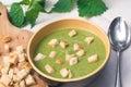 Green nettle soup in bowl
