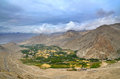 Green oasis and yellow mountains fields near ladakh s capital leh india Stock Photos