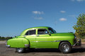 Green old car in cuba on a cuban highway restplace Stock Images