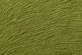 Green olive background from soft textile material. Fabric with natural texture. Royalty Free Stock Photo