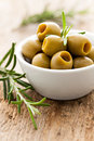 Green olives in a bowl with rosemary Royalty Free Stock Photos