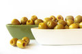 Green olives in ceramic bowls on white background Royalty Free Stock Photo