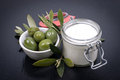 Green olives and cosmetics on a slate Stock Photos