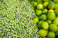 Green olives and lemons in the mediterranean market Royalty Free Stock Images