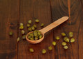 Green olives on the spoon wooden table Royalty Free Stock Photos