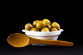 Green olives in a white bowl. Royalty Free Stock Photo