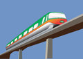 A green and orange monorail train on a bridge Stock Images