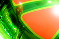 Green and Orange Mylar Balloon Stock Photo