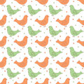 Green and orange ornate birds with dots in the background
