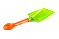 Green and orange plastic kids spade Stock Images