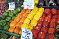 Green, Orange, Yellow, Red, Bell Peppers Displayed At Market Royalty Free Stock Photo