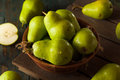 Green organic bartlett pears in a bowl Royalty Free Stock Photo