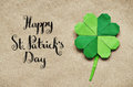 Green origami paper shamrock clover leaf on eco paper background Royalty Free Stock Photo