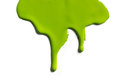 Green paint dripping isolated on a white background Royalty Free Stock Photos