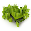 Green pallet truck full of green shopping bags Royalty Free Stock Photo