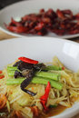 Green papaya salad and pork jerky white plate Stock Image