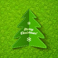 Green paper christmas tree greeting card with sign on ornate background Royalty Free Stock Photo