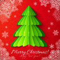 Green paper christmas tree on red background vector ornate with snowflakes Stock Images