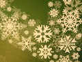 Green paper with white snowflakes Royalty Free Stock Photography