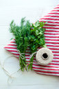 Green parsley and dill leaves on natural linen napkin on wooden background Royalty Free Stock Photo