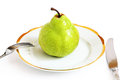 Green pear on a white plate big background Royalty Free Stock Photography