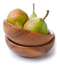 Green pears in a wooden bowl Royalty Free Stock Photo