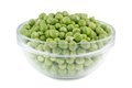 Green peas in a glass bowl. Royalty Free Stock Photo