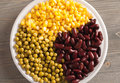 Green peas, sweet corn and beans in a white plate Royalty Free Stock Photo