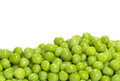 Green peas on a white background Royalty Free Stock Image