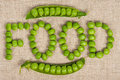 Green peas word food laid out by on a burlap Royalty Free Stock Photo