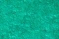 Green pebble dash textured dashing on side of house Stock Photo