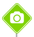 Green pemissive traffic sign with camera icon