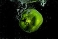 Green pepper plunging in water Royalty Free Stock Photo