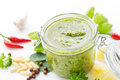 Green pesto in a preserving jar with ingredients Stock Images