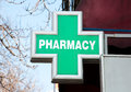 Green pharmacy sign on the street Stock Image