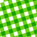 Green picnic cloth with some squares in it Stock Photo
