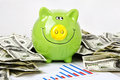 Green piggy bank and chart Stock Photography