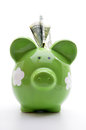 Green piggy bank with US dollar bills Royalty Free Stock Photo