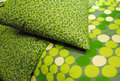 Green Pillow and Bedspread Stock Photography