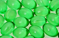Green pills transparent close up Stock Image