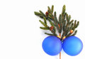 Green pine branch with cones and two blue christmas balls Royalty Free Stock Photo