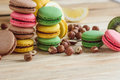 Green, pink, yellow and brown french macarons with lemon, kiwi and hazelnuts
