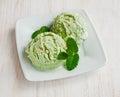 Green pistachio ice cream scoops Royalty Free Stock Photo