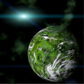 Green planet on galactic background Stock Photography